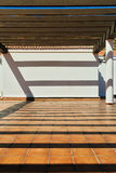 Terrace with shadows from the pergola Royalty Free Stock Photo