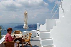 On the terrace, the shore of the Aegean sea, Santorini, Greece. Stock Photos