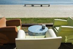 Terrace sofa and riverwalk. Outdoors setting Royalty Free Stock Image