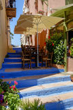 Terrace on a stairway in a narrow street Royalty Free Stock Image
