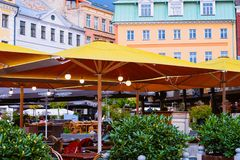 Terrace street cafe in Old Town of Riga Latvia. Riga, Latvia - September 1, 2018: Terrace street cafe in the Old Town of Riga of Latvia royalty free stock photography