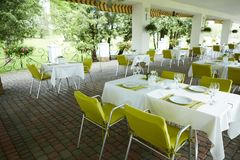 Terrace summer cafe with tables and chairs for people, an empty institution for recreation, nobody.  royalty free stock photo