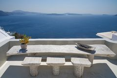 Terrace with table on the sea Oia - Santorini Island - Aegean sea - Greece. View of Terrace with table on the sea Oia - Santorini Island - Aegean sea - Greece royalty free stock photography