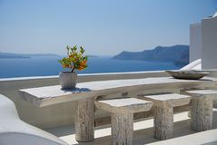 Terrace with table on the sea Oia - Santorini Island - Aegean sea - Greece. View of Terrace with table on the sea Oia - Santorini Island - Aegean sea - Greece royalty free stock images