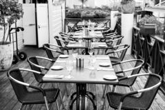 Terrace with tables, chairs and cutlery in philipsburg, sint maarten. Restaurant open air. Eating and dining outdoor. Summer vacation at Caribbean island stock images