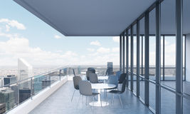 A terrace with tables and chairs in a modern panoramic building. 3D rendering. Stock Image