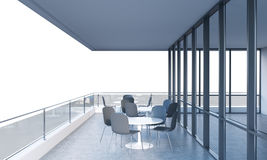 A terrace with tables and chairs in a modern panoramic building. 3D rendering. Royalty Free Stock Photography