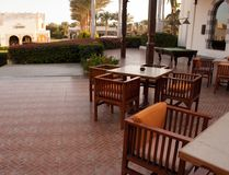 Terrace with tables and chairs. Summer cafe terrace. Exterior place for lunch nopeople stock image