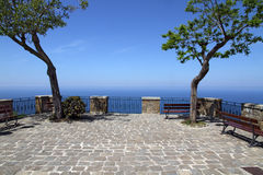 Terrace with trees and sea view. Cobble-paved terrace in Castellabate, Italy Stock Photography