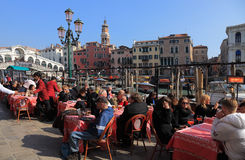 Terrace in Venice. Venice,Italy- February 25th, 2011: Many tourists enjoy a traditional Italian lunch on a restaurant terrace in Venice, in the vicinity of Stock Photo