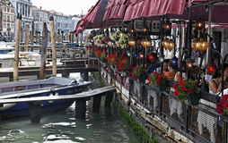 Terrace in Venice. Venice,Italy- July 28th, 2011: Many tourists enjoy a traditional Italian lunch on a restaurant terrace in Venice, in the vicinity of Rialto Stock Photos