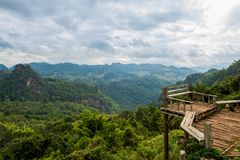 Terrace view with safety bar in the forest mountain valley Royalty Free Stock Image