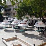 Terrace with white umbrellas. Stock Photo