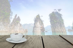 Terrace wood and cappuccino coffee with fade out of scenery view. Stock Photography