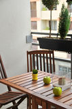 Terrace with wooden table and chairs. Terrace with wooden table and two chairs and decor Stock Image