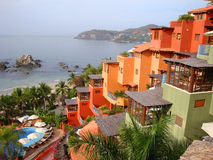 Terraced colorful resort on Mexico's Pacific Coast. A contemporary architecturally well designed resort with vivid colors using oranges, yellows and greens stock photos