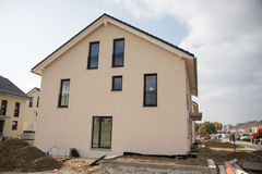 Terraced house , newly built , Shell in Germany. Building newly in germany, munich, with a blue sky stock photography