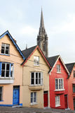 Terraced houses. Cobh, Ireland. Terraced houses with the St. Colman's cathedral in the background. Cobh, County Cork, Ireland Stock Photography