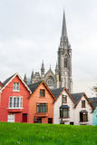 Terraced houses. Cobh, Ireland. Terraced houses with the St. Colman's cathedral in the background. Cobh, County Cork, Ireland Stock Photo