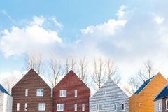 Terraced houses with minimalist design and classic gabled roof Royalty Free Stock Photos
