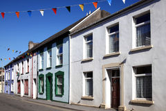 Terraced town houses. Old fashioned colourful terraced town houses in Kidwelly, Carmarthenshire, Wales, UK Royalty Free Stock Images