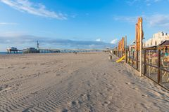 Terraces along the Dutch beach with a view at the Pier of Scheveningen Stock Image