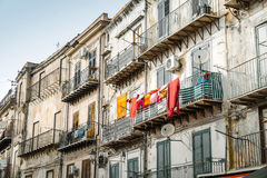 Terraces and balconies. Palermo, Italy - May 11, 2016: Terraces and balconies of old buildings in Albergheria district, Palermo, Italy Royalty Free Stock Photo