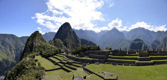 Terraces of Machu Pichu with Huayna Picchu. Panorama of Terraces Machu Pichu with Huayna Picchu in Peru, rainforest jungle and mountains with blue sky in the stock photo