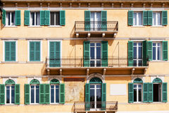 Terraces and windows of an old building in Verona Stock Photo