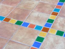 Terracotta. Mexican terracotta flagstones with a colorful bordure Stock Image