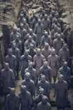 Terracotta Army, China. Xi`an, China - May 27, 2017: Lines of clay statues of ancient chinese warriors, guards of Qin Shi Huang emperor, so called Terracotta stock photography