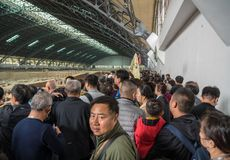 Terracotta Army warriors buried in Emperor tomb outside Xian China. XI`AN, CHINA - 17 OCTOBER 2018: Tourists inside building housing the pottery terracotta army stock photography