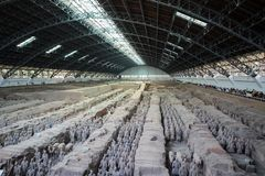 Terracotta Army or warriors outside of Xi`an China. Xian, Shannxi, China - 2019-04-17: The Terracotta Army inside a pavilion depicting the armies of Qin Shi royalty free stock photography