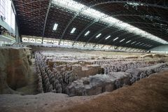 Terracotta Army or warriors outside of Xi`an China. Xian, Shannxi, China - 2019-04-17: The Terracotta Army inside a pavilion depicting the armies of Qin Shi royalty free stock image