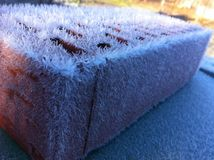 Terracotta brick. Covered with ice in the winter morning Stock Photos