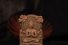 Terracotta Buddha of Sarnath, Varanasi, India in meditative peaceful posture royalty free stock image