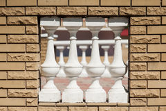 Terracotta ceramic white mini column to make void on wall for wind blow Royalty Free Stock Image