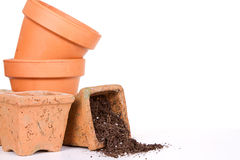 Terracotta or clay gardening pots with dirt spilling Royalty Free Stock Image