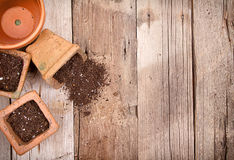 Terracotta or clay gardening pots with dirt spilling Stock Photos