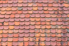 Terracotta Clay Roof Tiles. Terracotta clay roof shingles background Stock Photos