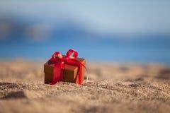 Terracotta color gift box ona beach Royalty Free Stock Photo