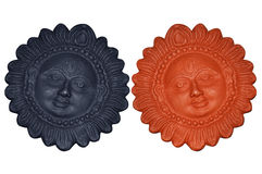 Terracotta couple sun faces Royalty Free Stock Photo