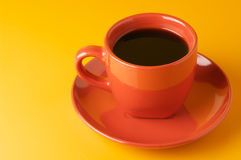 Terracotta cup of coffee Stock Images
