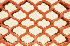 Terracotta decorative latticework fence. Fragment of a terracotta decorative latticework fence Royalty Free Stock Photos