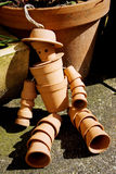Terracotta flower pot man Stock Images