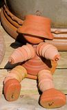 Terracotta flowerpot man. Royalty Free Stock Images