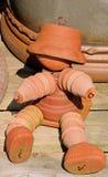 Terracotta flowerpot man. Royalty Free Stock Images