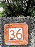A terracotta house number royalty free stock image