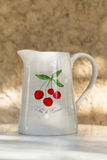 Terracotta Jug with Cherries Stock Image