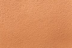 Terracotta painted stucco wall. Royalty Free Stock Photos